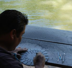 slate carving at river